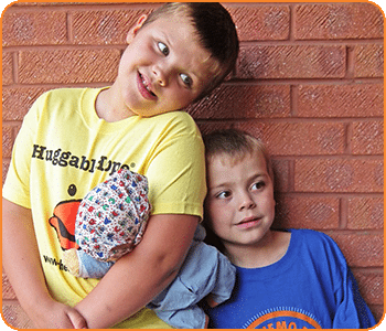 Zack, pictured left, with his younger brother Toby.
